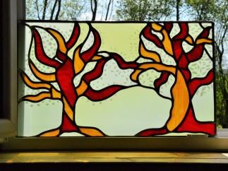 Création à l'occasion d'un jumelage entre deux villages, l'un breton représenté par le pommier, l'autre italien représenté par l'olivier. Enlacés les branches des arbres symbolisent le lien qui unit ces deux villages.